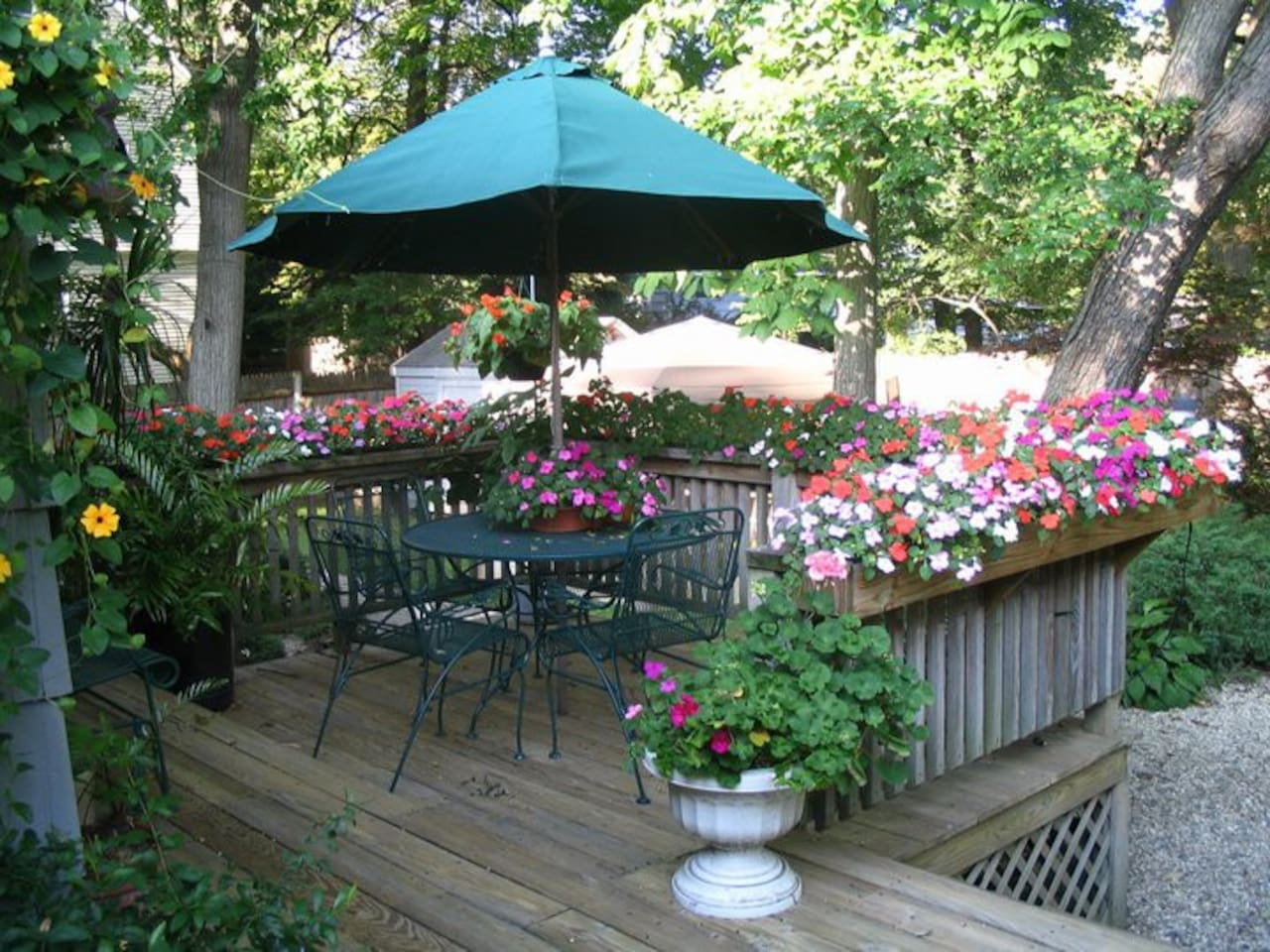 Large deck with multiple sitting areas overlooks Japanese style garden with water features. Enjoy your breakfast or evening wine here; you can also cook on a gas grill.
