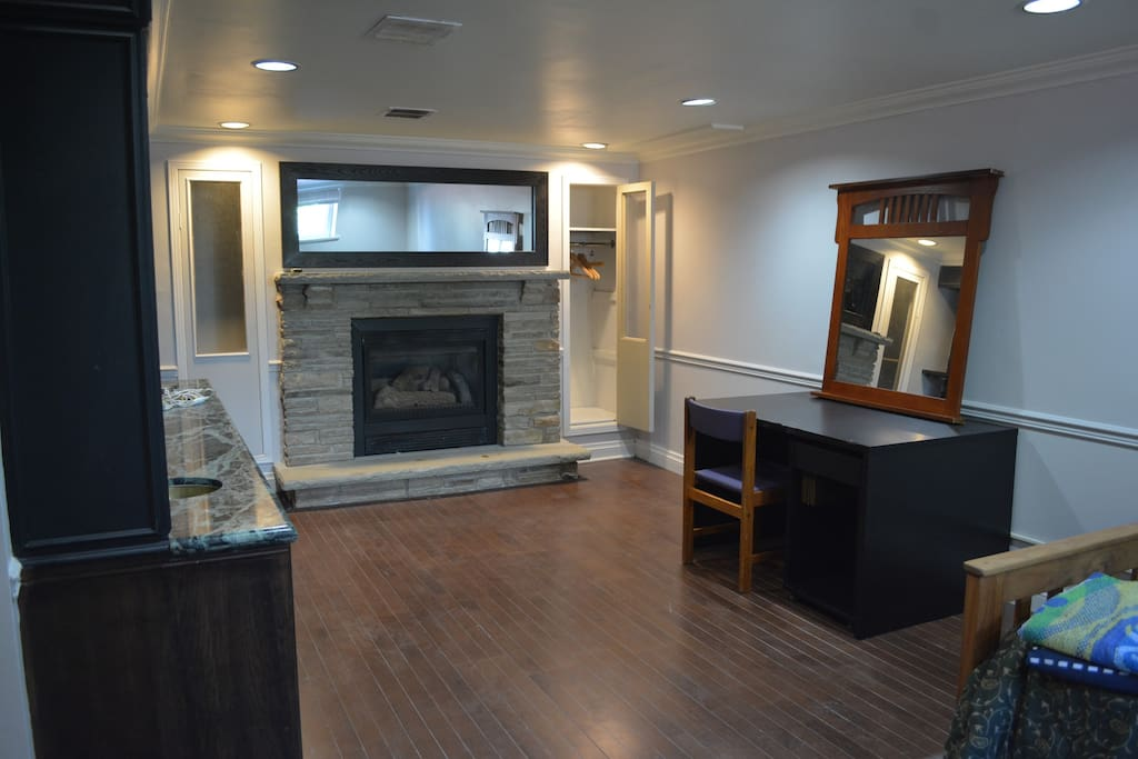 there is also a working fireplace in the bedroom (for winter use only). This room has so many storage areas!