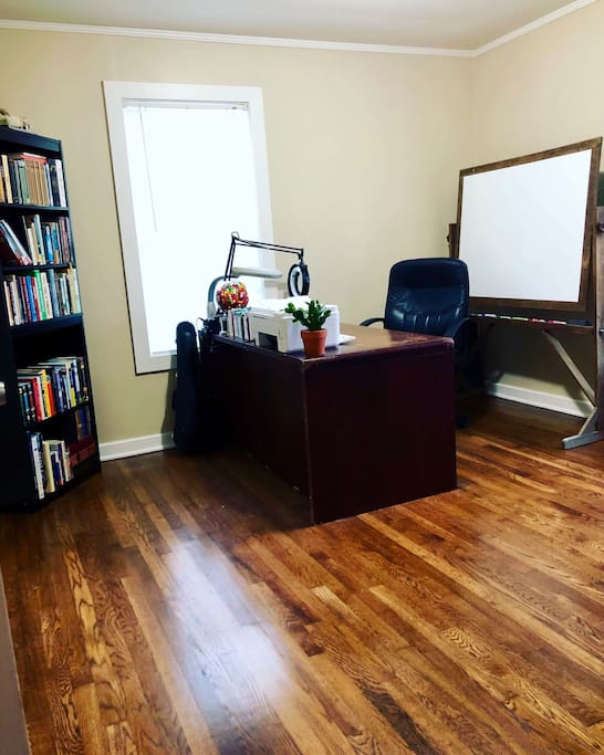 Spare room; large desk, white board, scanner, printer