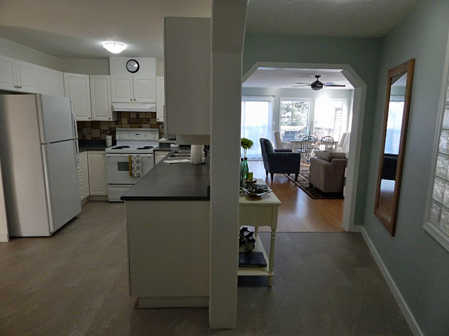 As you come in the front door spacious entry and view of both kitchen and living area