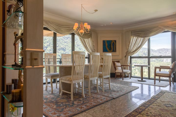 This dinning room overlooks Sao Conrado beach, the  Gave Golf Club and the Tijuca forest