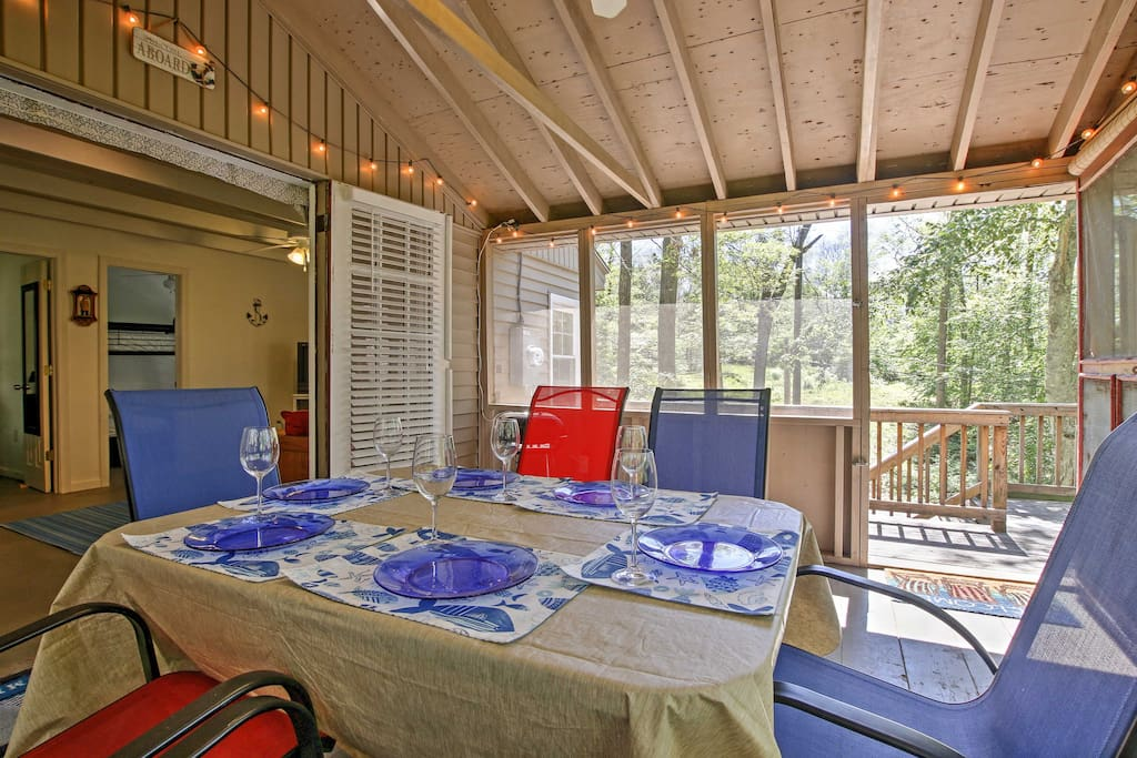The screened-in back porch is ideal for dining on warm summer evenings.