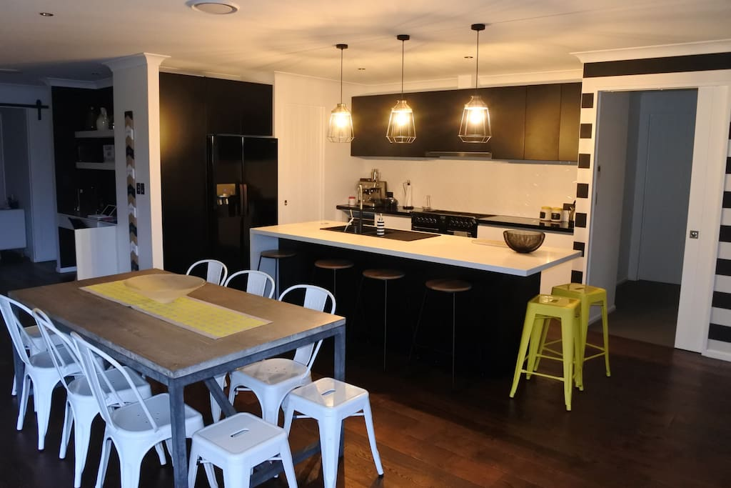 Open plan kitchen with a breakfast bar that seats 6 and a table that sits 10