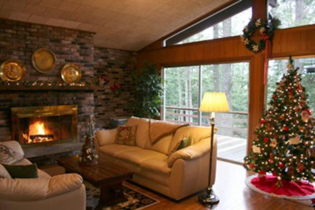 upstairs living room with wood burning fireplace
