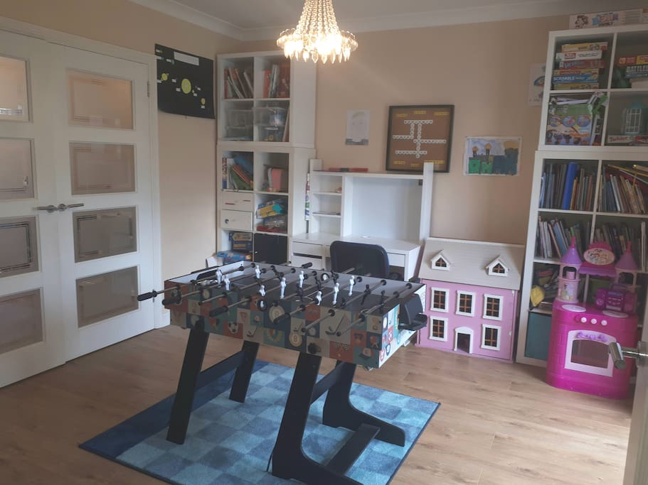 Playroom with table football/ table tennis table, board games and toys