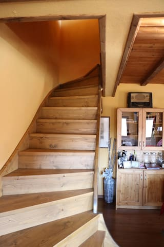 Wooden Stairs for the Loft. We dont use shoes in the house. Floor is wooden