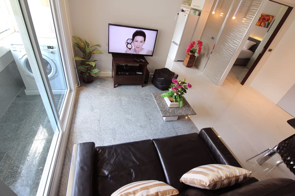 The living room and view to balcony where you have washing maschine