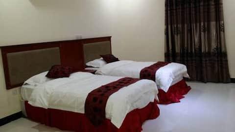 غرفة فندقية بسريرين مفردين ... عناية جيدة