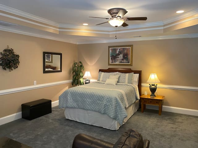 High-end queen size mattress with plush pillows for a relaxing, restful sleep.