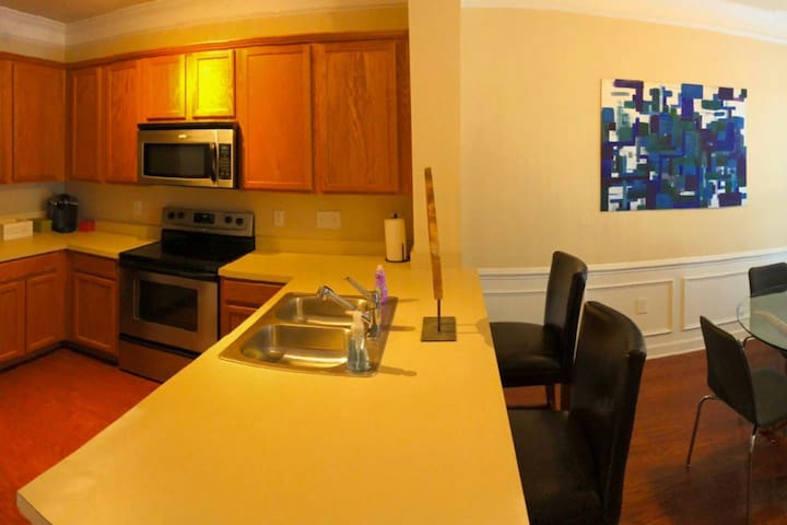Kitchen with bar seating. Great for quick meals and a little evening work on the laptop.