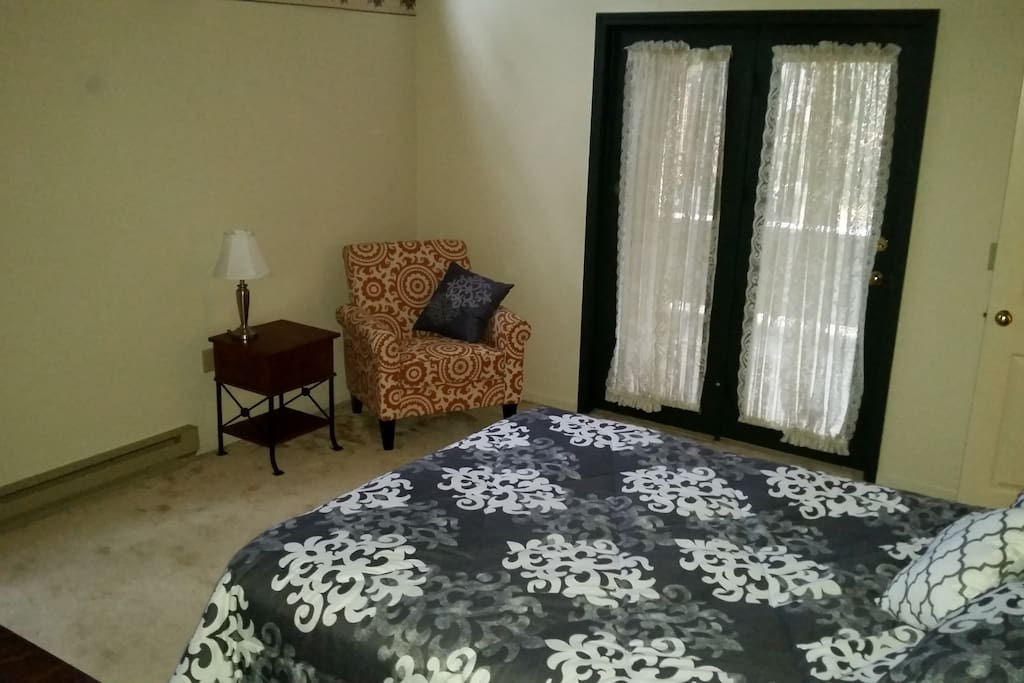Master Bedroom With a Queen Bed and Balcony