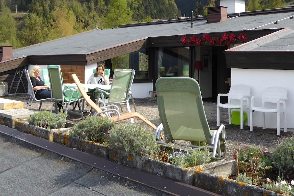 Terrace with sundeck chairs, table and BBQ