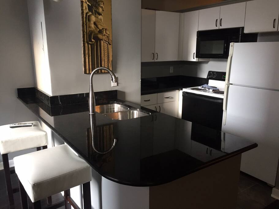Newly installed black granite with upgraded faucet and sink