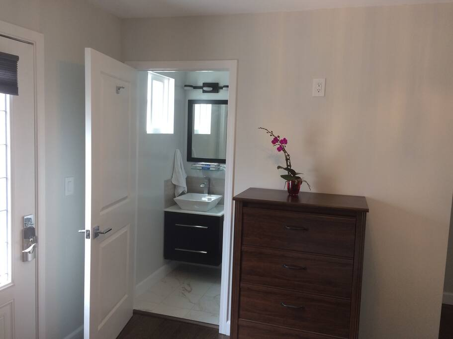 small private bath and dresser