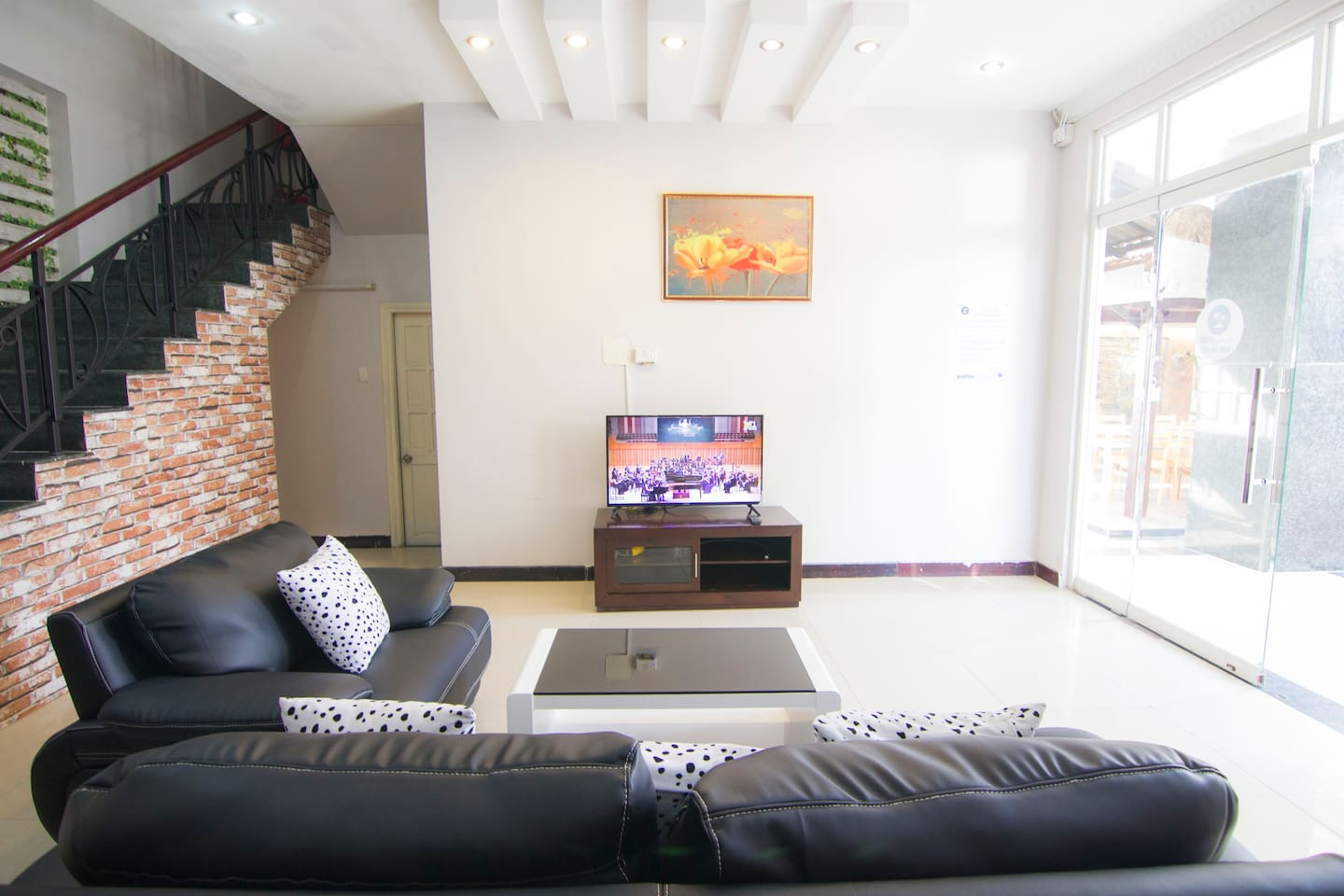Vung Tau Villa Ali 5B has a modern spacious living room in ground floor with TV, sofa,..