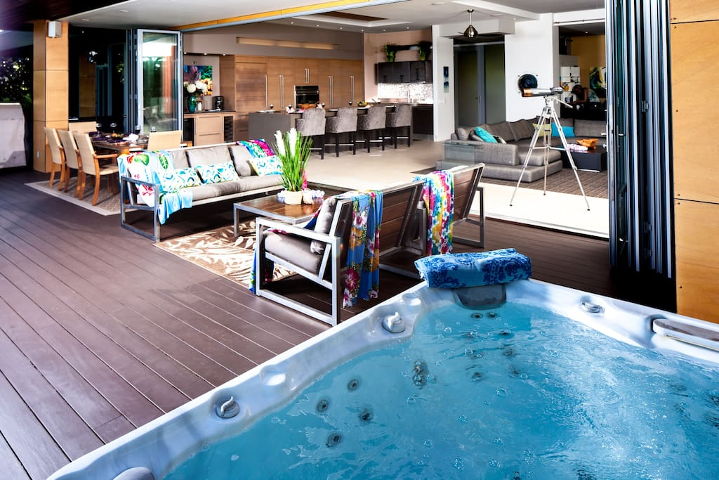 Deck and Hot tub and great room in background