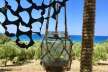 Citronella candle lantern hanging from the shade