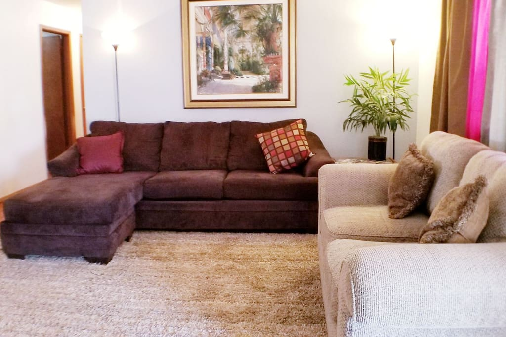 """Enjoy relaxing in this spacious living room while watching your favorite Netflix or YouTube show on a 43"""" flat screen """"smart"""" TV"""