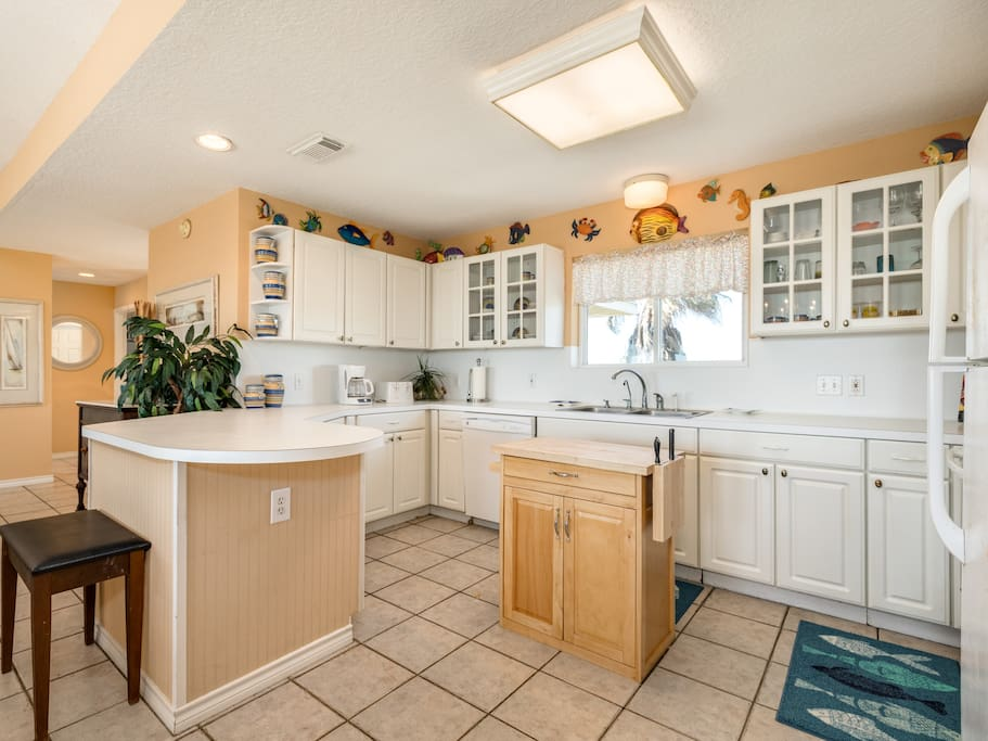 The well-equipped kitchen includes a starter supply of dish soap and paper towels for your convenience.