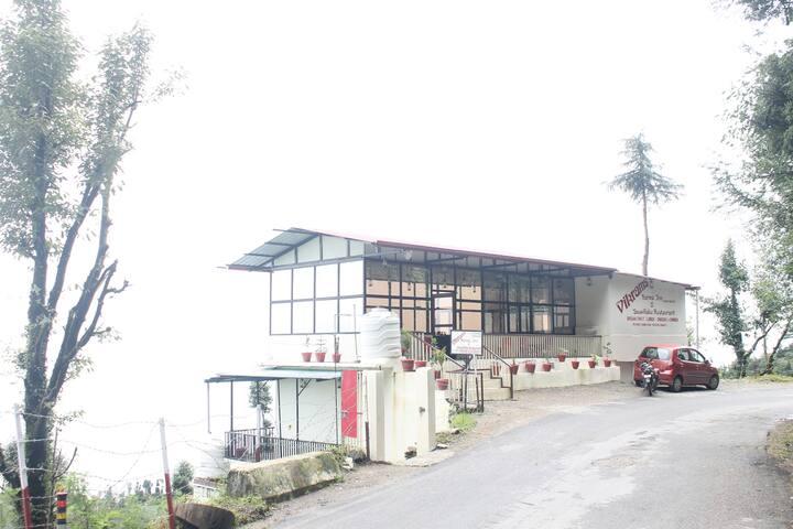 Vikram's Karma Inn Dhanaulti overlooking Himalaya.