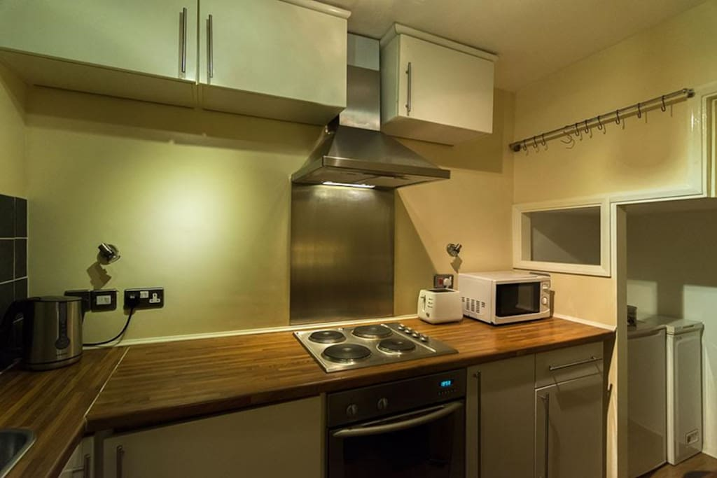 Galley kitchen with all amenities