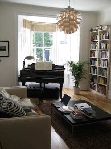 Living room with the baby grand