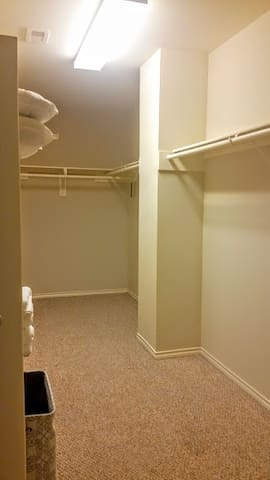 3rd Floor walk in closet in Primary Bedroom.  Extra bed sheets, pillows, towels, blankets, toiletries, and other items available for your use