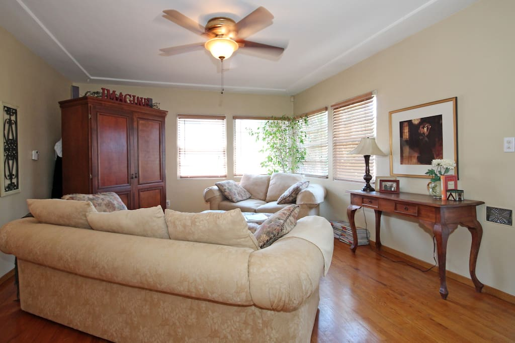 Five people can relax and put their feet up in the living room. The entertainment center is housed in the armoire.