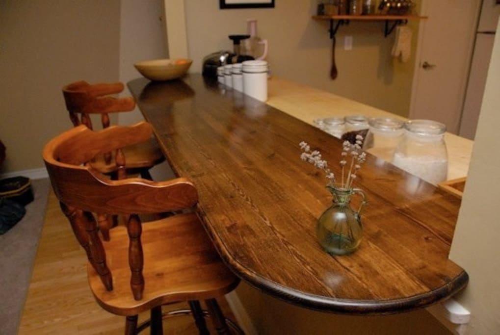 Beautiful solid wood breakfast bar, seats two.