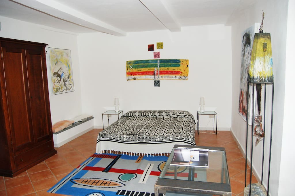 The larger bedroom with 1 double bed and 1 single bed or 3 single beds.