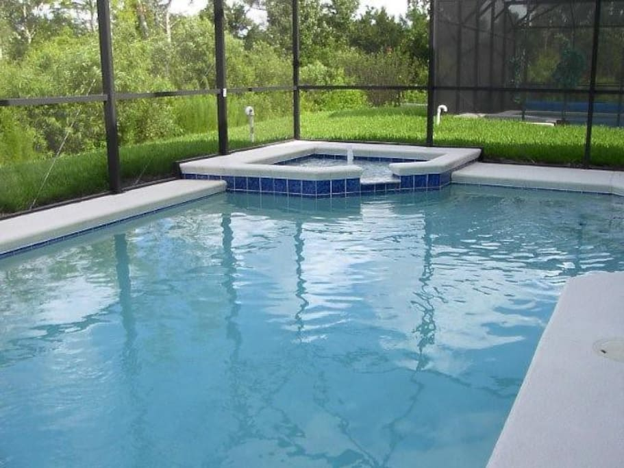 Heated pool with attached jacuzzi spa