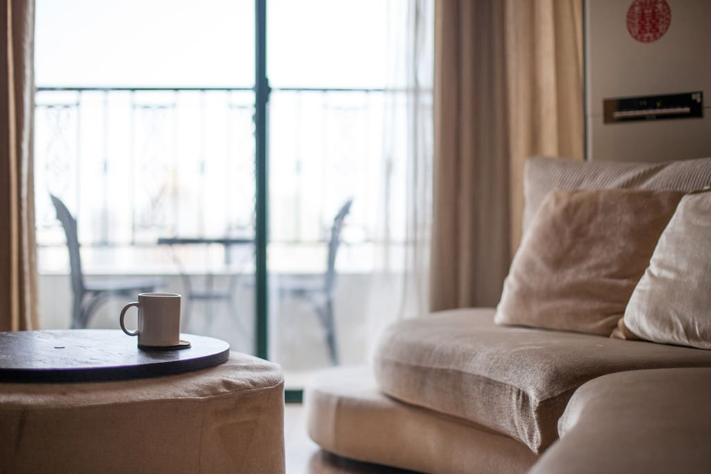 Enjoy a fresh cup of coffee on our comfortable couch or on the private balcony