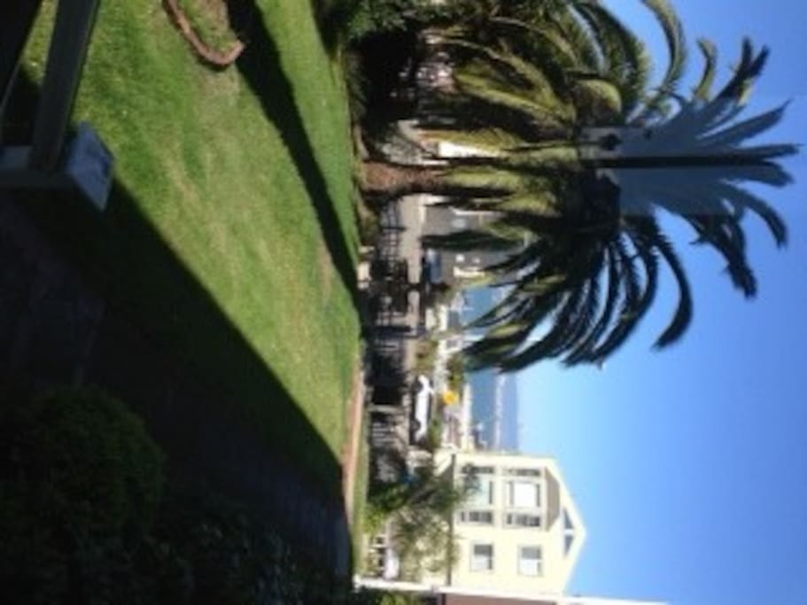 Gated corner lot with manicured garden and stunning views of the bay