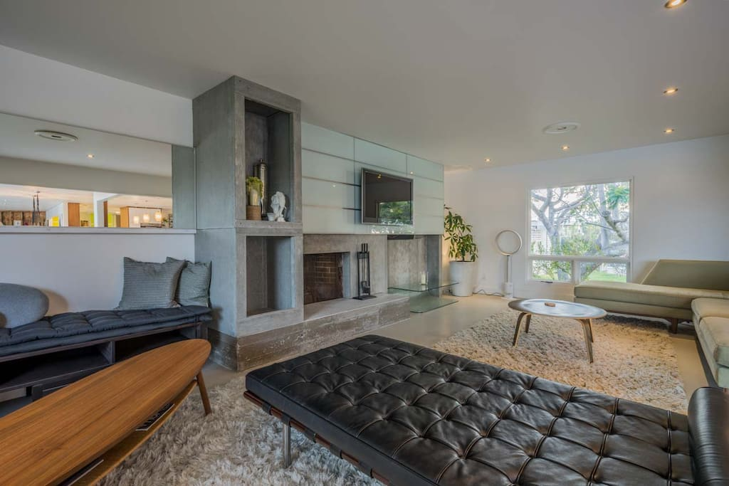 Huge living room with multiple seating areas, all open to the kitchen and dining areas for wonderful entertaining.
