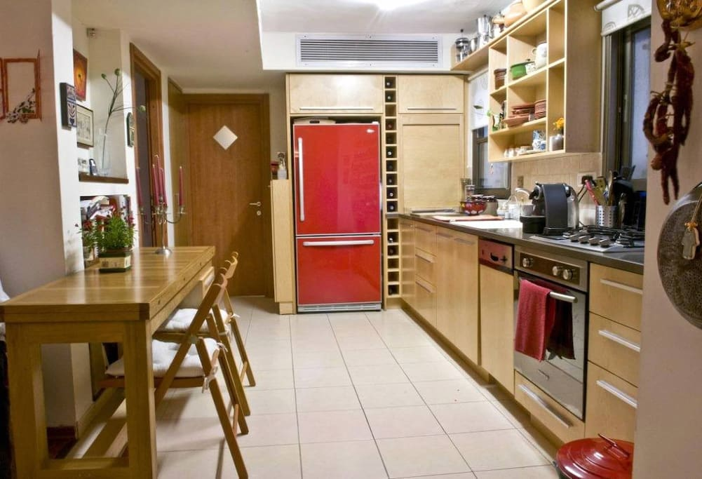 Fully equipped kitchen, entrance to second bedroom and second bathroom with walk-in spacious shower unit