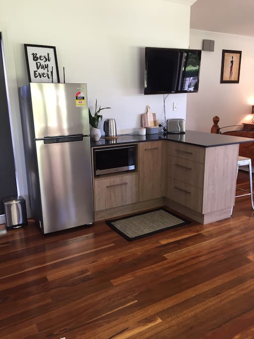 Full size fridge and new microwave, toaster jug and coffee machine