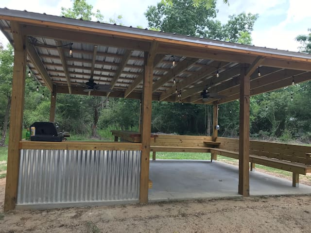 Covered outdoor entertainment area. Relax at the bar or the benches and enjoy nature and a cool drink.