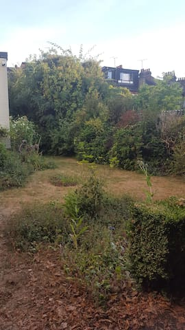 Our lovely communal garden next to the park. We like sunbathing here and having summer suppers and bbqs.