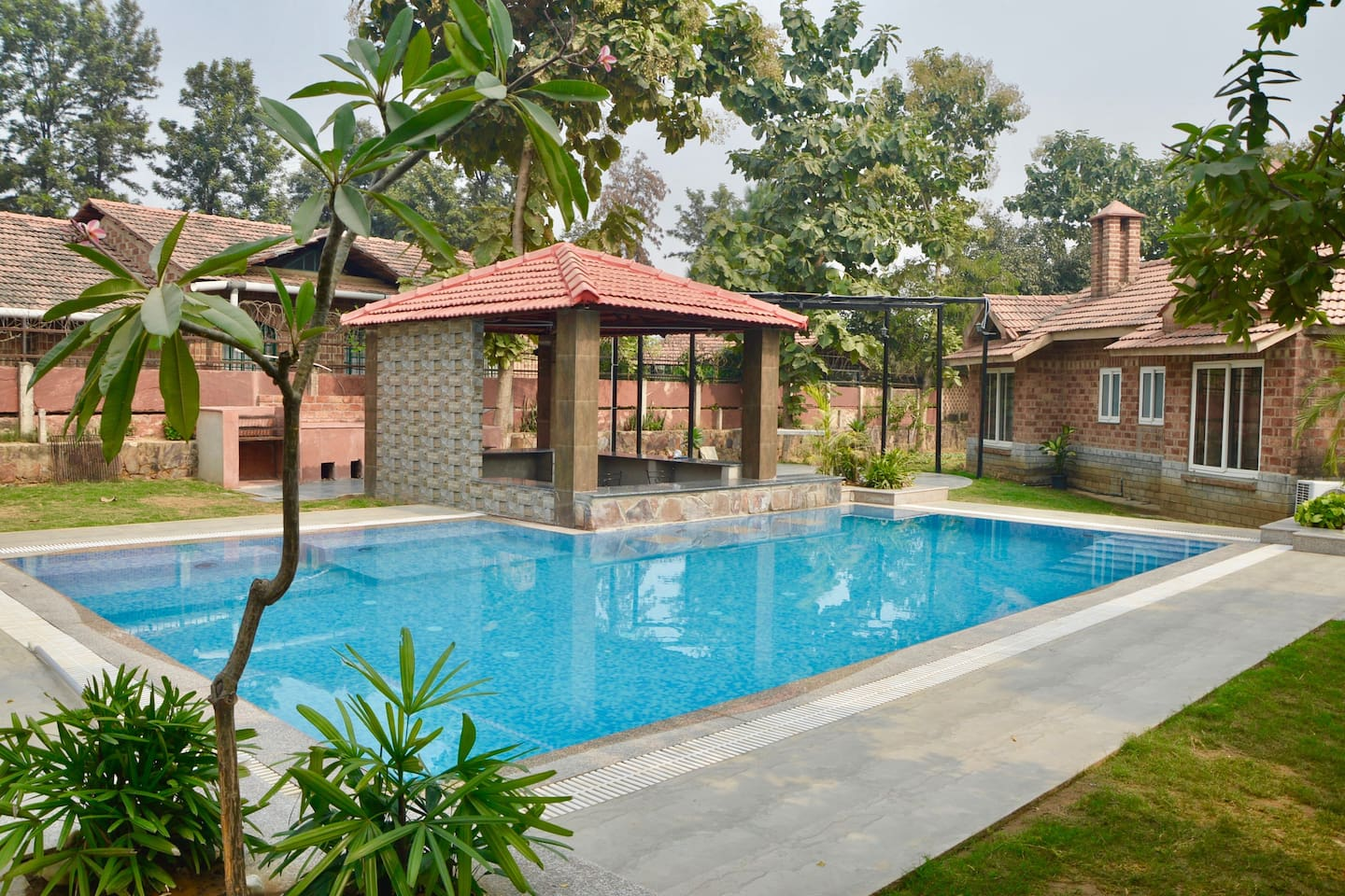 Newly constructed swimming pool with attached deck, gazebo and BBQ pitts
