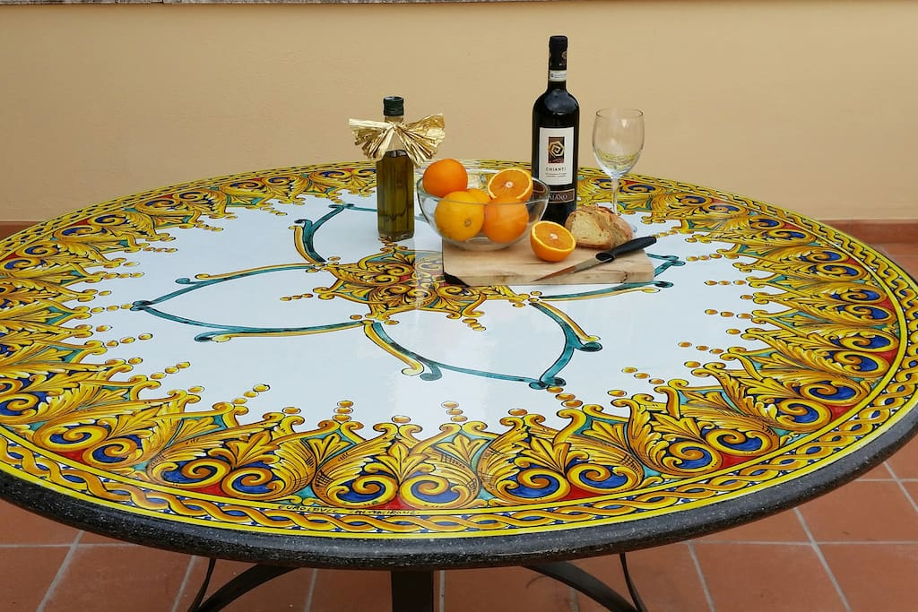 special touches - our terrace table - hand painted lava table