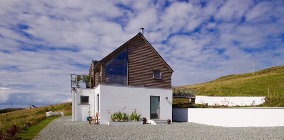 Ours is an upside down house. This means that the daytime living area is in the roof! This is because the house is built into the brae (hill)