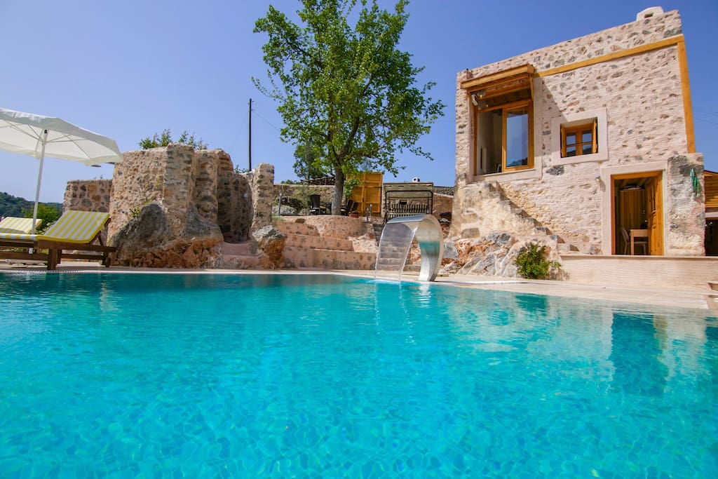 The luxury pool is spacious (40m² or 400ft²), featuring a mini-waterfall.