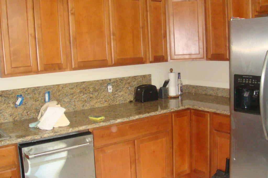 kitchen, dishwasher, disposal, stove, full size fridge.