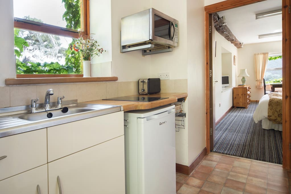 The kitchenette is separate from the main room and has a  kettle, toaster, 2 plate hob, combination microwave oven, fridge with small freezer compartment and all the necessary crockery, cutlery, pots and pans.