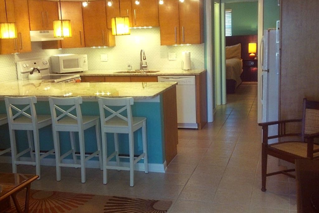 The remodeled kitchen includes custom  maple cabinets with granite.