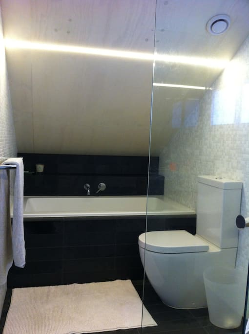 Attic ensuite with bath and shower