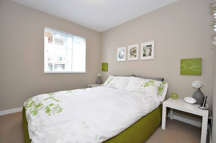 Green room with pillow top Queen Bed