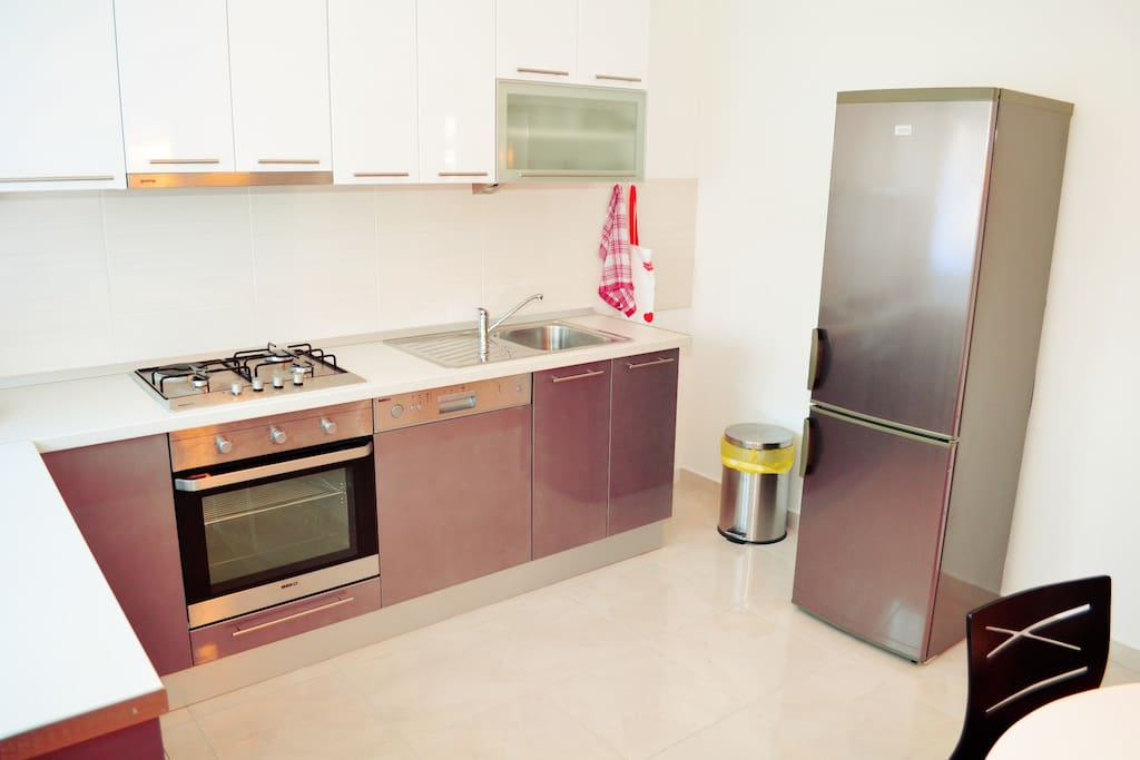 Fully equipped and spacious kitchen.