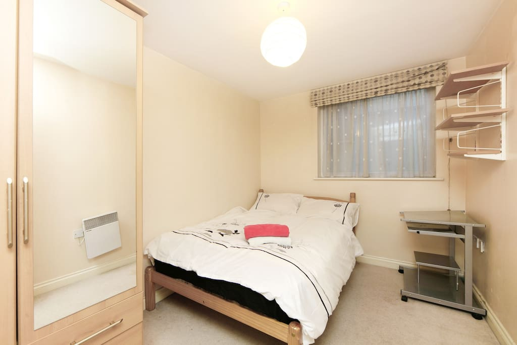 2nd bedroom with double bed  and double wardrobe
