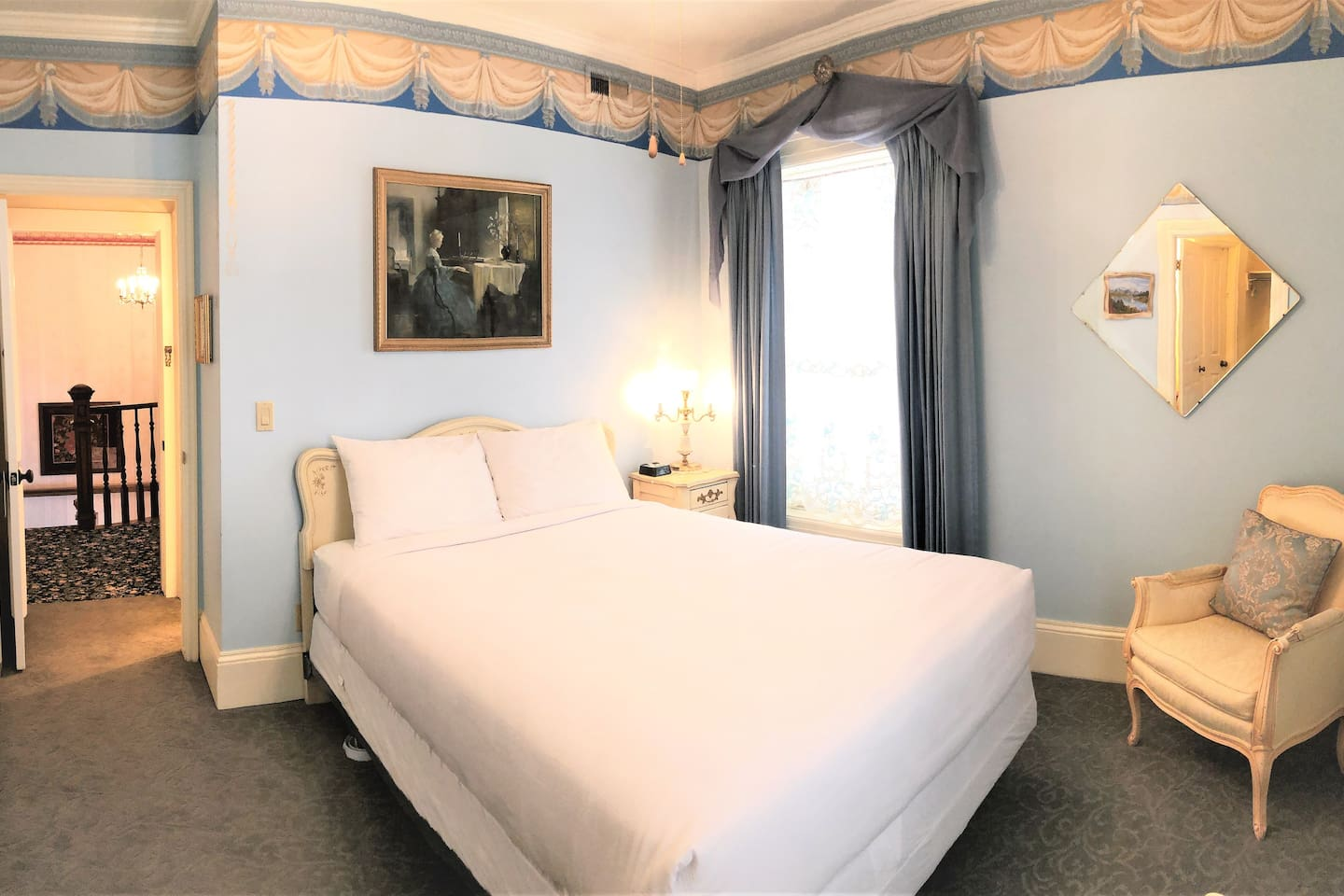 The Blue Room offers a queen bed and a private, 3/4 bath.  There is also an adjoining powder room with a desk area.  Other amenities include a ironing board with iron, a hair dryer and a digital clock with USB connectors.